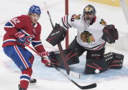 Montreal Canadiens' Artturi Lehkonen moves in on Chicago Blackhawks goaltender Corey Crawford during the second period of an NHL hockey game Wednesday, Jan. 15, 2020, in Montreal. (Graham Hughes/The Canadian Press via AP)