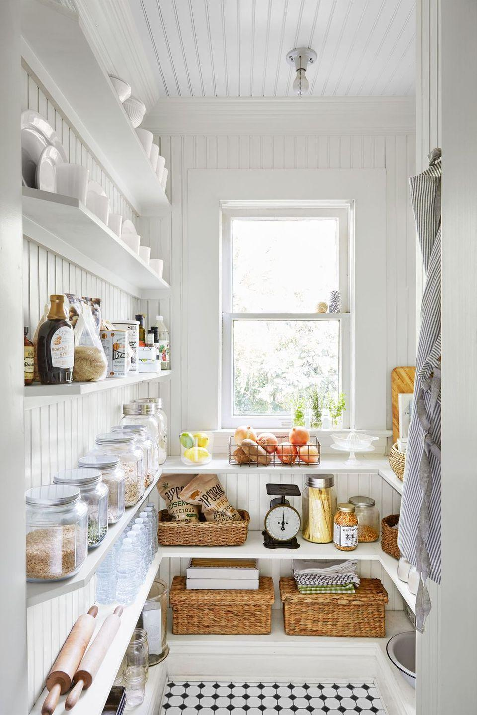 <p>Open shelving and beadboard paneling are both practical and attractive in this pantry. </p>