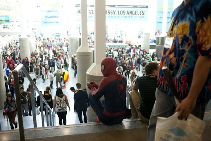 Spiderman takes a break on the stairs at Stan Lee's Comikaze Expo at the Los Angeles Convention Center in Los Angeles, CA., on Saturday, November, 1, 2014.
