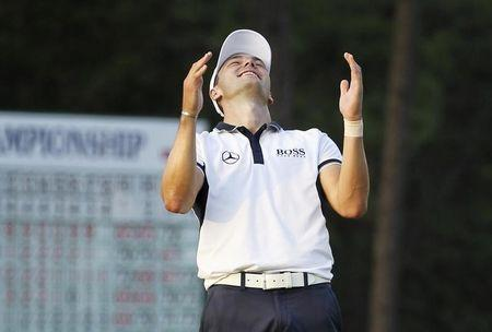 Martin Kaymer of Germany celebrates on the 18th green after winning the U.S. Open Championship golf tournament in Pinehurst, North Carolina, June 15, 2014. REUTERS/Robert Galbraith