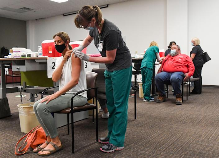 People receive the COVID-19 vaccine on Tuesday, April 6, 2021, at the Avera Health vaccine clinic in Sioux Falls.