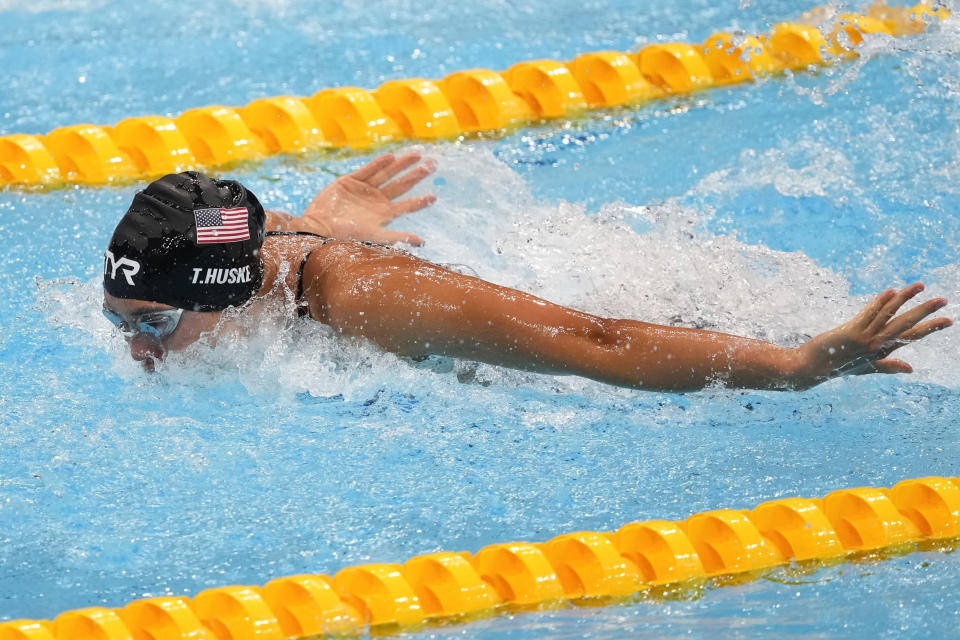 Torri Huske, of the United States, swims during a semifinal in the women's 100-meter butterfly at the 2020 Summer Olympics, Sunday, July 25, 2021, in Tokyo, Japan. (AP Photo/Petr David Josek)