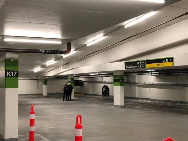 Police said the car crashed through a concrete wall on the parkade level.