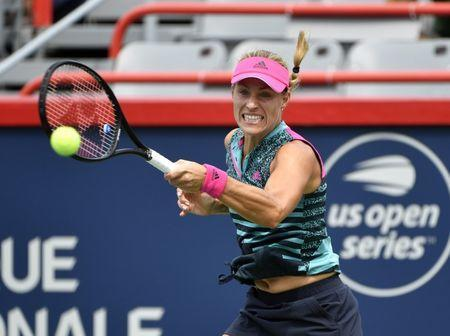 Aug 8, 2018; Montreal, Quebec, Canada; Angelique Kerber of Germany hits a forehand against Alize Cornet of France (not pictured) in the Rogers Cup tennis tournament at Stade IGA. Eric Bolte-USA TODAY Sports