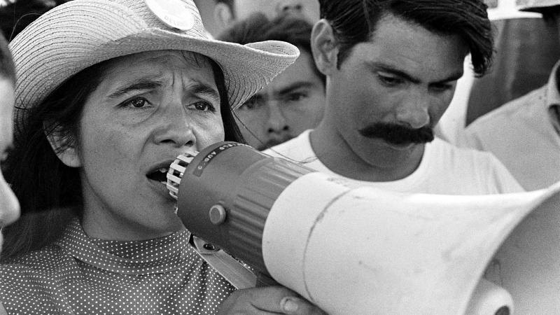 Dolores Huerta organizing marchers in 1969.  (courtesy of PBS Distribution)