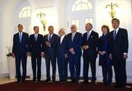U.S. Secretary of State John Kerry, Britain's Foreign Secretary Philip Hammond, Russian Foreign Minister Sergei Lavrov, Iranian Foreign Minister Javad Zarif, German Foreign Minister Frank-Walter Steinmeier, French Foreign Minister Laurent Fabius, EU envoy Catherine Ashton and Chinese Foreign Minister Wang Yi (LtoR) pose for photographers before a meeting in Vienna November 24, 2014. REUTERS/Leonhard Foeger