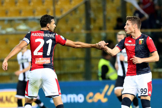 Genoa's Andrea Pinamonti, right, celebrates with his teammate Ivan Radovanovic after scoring his side's first goal during a Serie A soccer match between Parma and Genoa at the Ennio Tardini stadium in Parma, Italy, Sunday, Oct. 20, 2019. Parma won 5-1. (Serena Campanini/ANSA via AP)