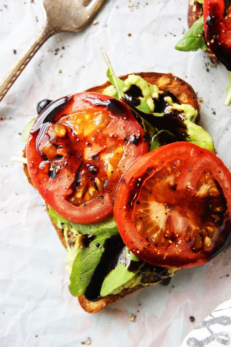 """<p>Not your average avocado toast.</p><p>Get the recipe from<span class=""""redactor-invisible-space""""> <a href=""""http://www.thegarlicdiaries.com/avocado-arugula-and-tomato-toasts-with-easy-balsamic-syrup/"""" rel=""""nofollow noopener"""" target=""""_blank"""" data-ylk=""""slk:The Garlic Diaries"""" class=""""link rapid-noclick-resp"""">The Garlic Diaries</a>.</span></p>"""