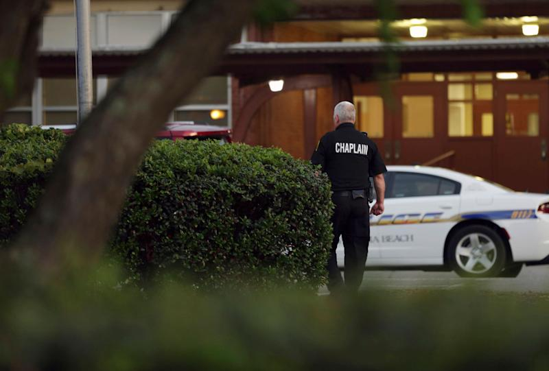 A police chaplain heads toward Princess Anne Middle School in Virginia Beach, Va, on Friday, May 31, 2019. (Photo: Vicki Cronis-Nohe/AP)