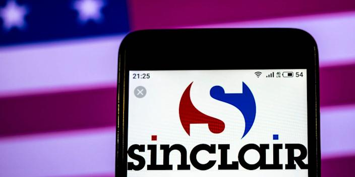 In this photo illustration, the Sinclair Broadcast Group Telecommunications company logo seen displayed on a smartphone.