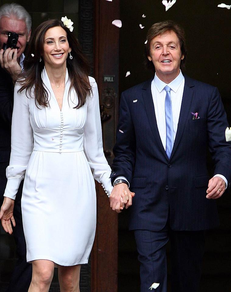 Legendary singer Paul McCartney and his bride Nancy Shevell emerged from their October 9 civil ceremony in London to fans throwing confetti. While he wore a blue suit, she sported an above-the-knee dress created, of course, by the former Beatle's daughter and fashion designer, Stella McCartney.