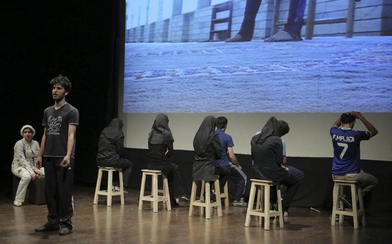 "In this undated photo, Iranian actors and actresses perform a scene from ""The Blue Feeling of Death,'' in Arasbaran Cultural Center in Tehran, Iran. The production, translated from Farsi as ""The Blue Feeling of Death,"" opened in June 2013, as a showcase of activist art against Iran's legal codes that allow death sentences for children — who then wait until their 18th birthday for possible execution. Opening night came even as Iranian officials tightened controls on the social media and other forms of political opposition before presidential elections, whose centrist winner, Hasan Rouhani, has brought hope of reversing some of the crackdowns. (AP Photo/Hadi Shabani)"