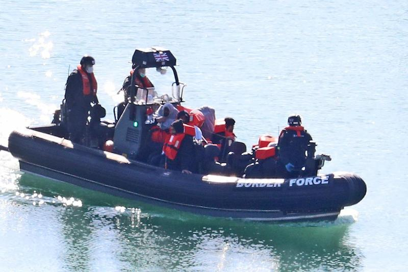 A file photo of Border Force officers bringing to shore men thought to be migrants in Dover, Kent, after a number of small boat incidents in the English Channel (PA)