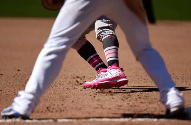 Boston Red Sox's Mookie Betts (50) sports a pair of pink shoes in celebration of Mother's Day during fifth-inning baseball game action against the Toronto Blue Jays in Toronto, Sunday, May 13, 2018. (Nathan Denette/The Canadian Press via AP)
