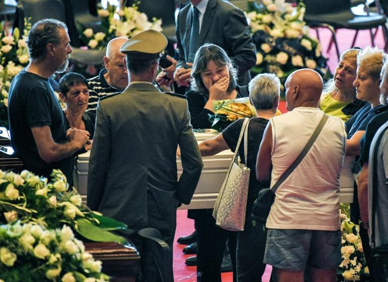 Relatives mourning in Genoa last month near the coffins of some of the victims of the collapsed bridge