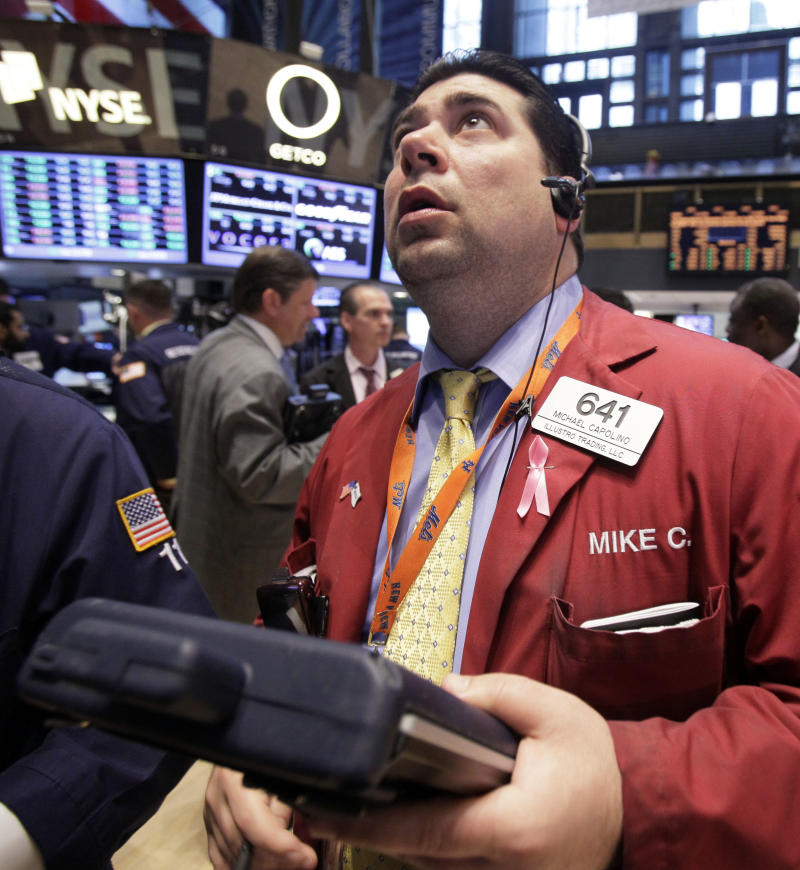 Trader Michael Capolino works on the floor of the New York Stock Exchange Tuesday, April 17, 2012.   Wall Street looked set for gains Thursday April 19, 2012 with Dow Jones industrial futures rising 0.5 percent and S&P 500 futures adding 0.6 percent. (AP Photo/Richard Drew)