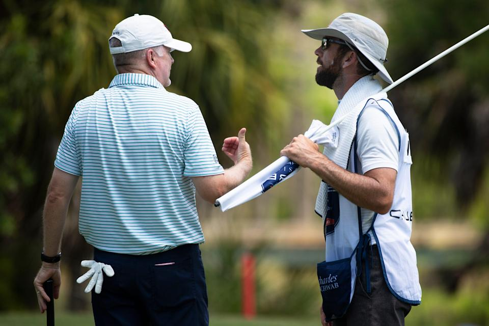 Craig Bowden, left, talks to his caddie, actor Lucas Black, right, during day two of the Chubb Classic.