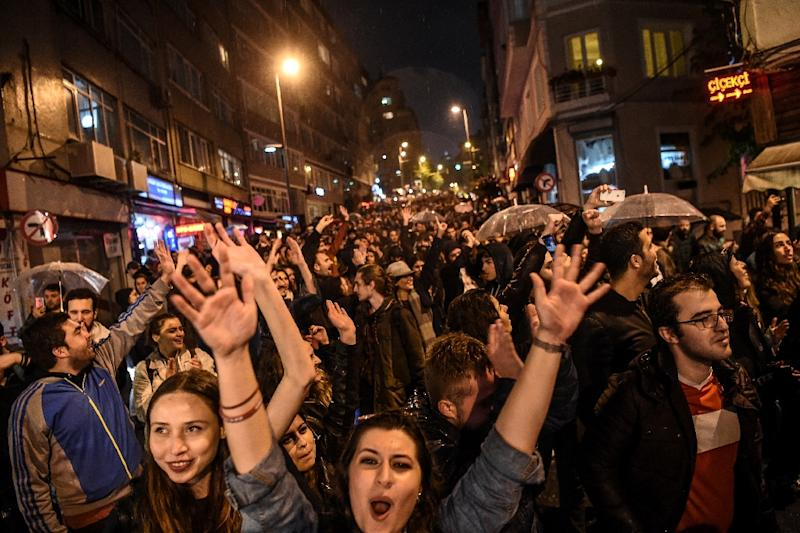 """Supporters of the """"No"""" gesture and shout in Istanbul to protest alleged poll violations"""