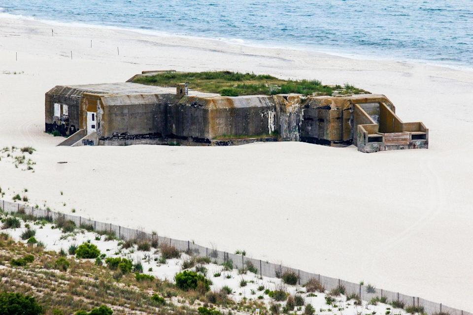 <p>Built on the sand off the coast of Cape May in New Jersey, the Cape May Bunker served as a gun placement to protect America's East Coast. It was constructed at the beginning of World War II when military leaders believed that war would come to American shores. The site is now part of a state park.</p>