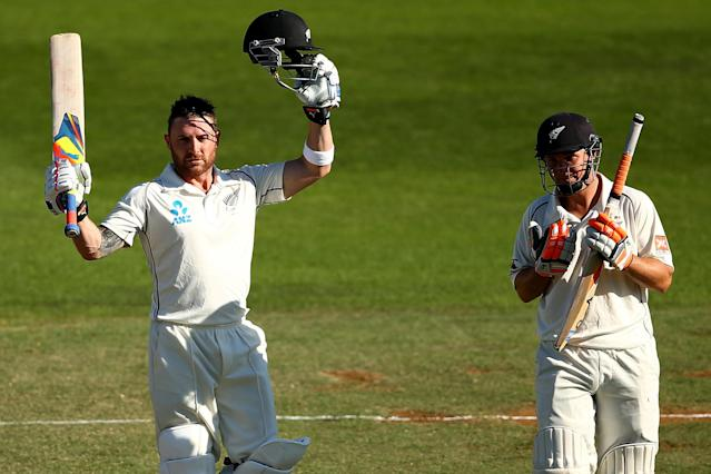 WELLINGTON, NEW ZEALAND - FEBRUARY 16: Brendon McCullum of New Zealand celebrates his century (L) as BJ Watling (R) looks on during day three of the 2nd Test match between New Zealand and India at the Basin Reserve on February 16, 2014 in Wellington, New Zealand. (Photo by Phil Walter/Getty Images)