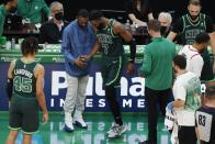 Boston Celtics' Kemba Walker, center left, helps Jaylen Brown (7) after Brown collided with teammate Jayson Tatum during the second half of an NBA basketball game against the Portland Trail Blazers, Sunday, May 2, 2021, in Boston. (AP Photo/Michael Dwyer)
