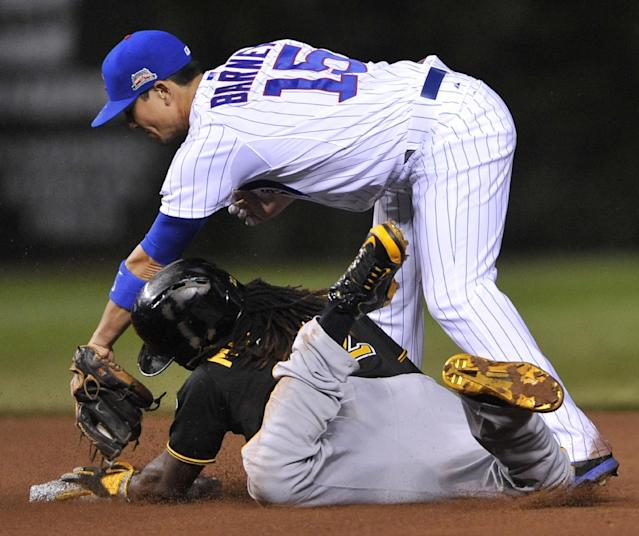 Chicago Cubs second baseman Darwin Barney (15) attempts to apply the tag while Pittsburgh Pirates' Andrew McCutchen steals second base safely during the fourth inning of a baseball game in Chicago, Saturday, June 21, 2014. (AP Photo/Paul Beaty)