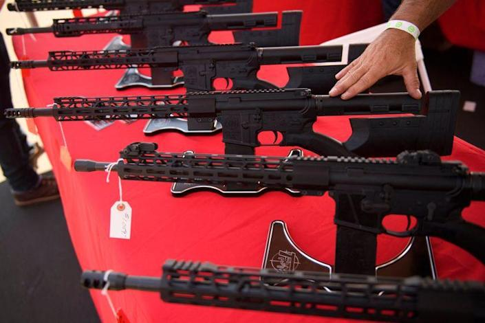 """A TPM Arms LLC California-legal featureless AR-15 style rifle is displayed for sale at the company's booth at the Crossroads of the West Gun Show at the Orange County Fairgrounds on June 5, 2021 in Costa Mesa, California. - Gun sales increased in the US following Covid-19 pandemic lockdowns. On June 4, a San Diego federal court judge overturned California's three-decade old ban on assault weapons, defined as a semiautomatic rifle or pistol with a detachable magazine and certain features, but granted a 30-day stay for a State appeal and likely future court decisions on the constitutionality of the ban under the Second Amendment. An industry of California legal """"featureless"""" or """"compliant"""" AR-15 style rifles developed for California consumers, adapting to the law with design changes to the popular rifle. (Photo by Patrick T. FALLON / AFP) (Photo by PATRICK T. FALLON/AFP via Getty Images)"""