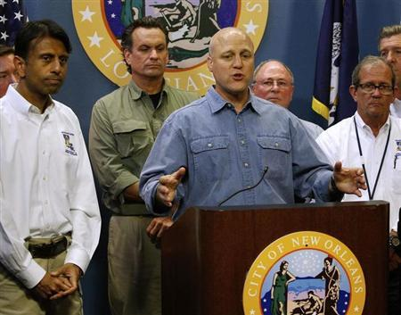 New Orleans Mayor Mitch Landrieu talks about Tropical Storm Isaac as Louisiana Governor Bobby Jindal looks on during a news conference in New Orleans