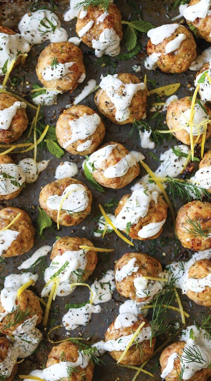 """<p>Say goodbye to sad, dry turkey meatballs forever. </p><p><em><a href=""""http://damndelicious.net/2016/10/13/greek-turkey-meatballs/"""" rel=""""nofollow noopener"""" target=""""_blank"""" data-ylk=""""slk:Get the recipe from Damn Delicious »"""" class=""""link rapid-noclick-resp""""><span class=""""redactor-invisible-space"""">Get the recipe from Damn Delicious »</span> </a></em></p>"""