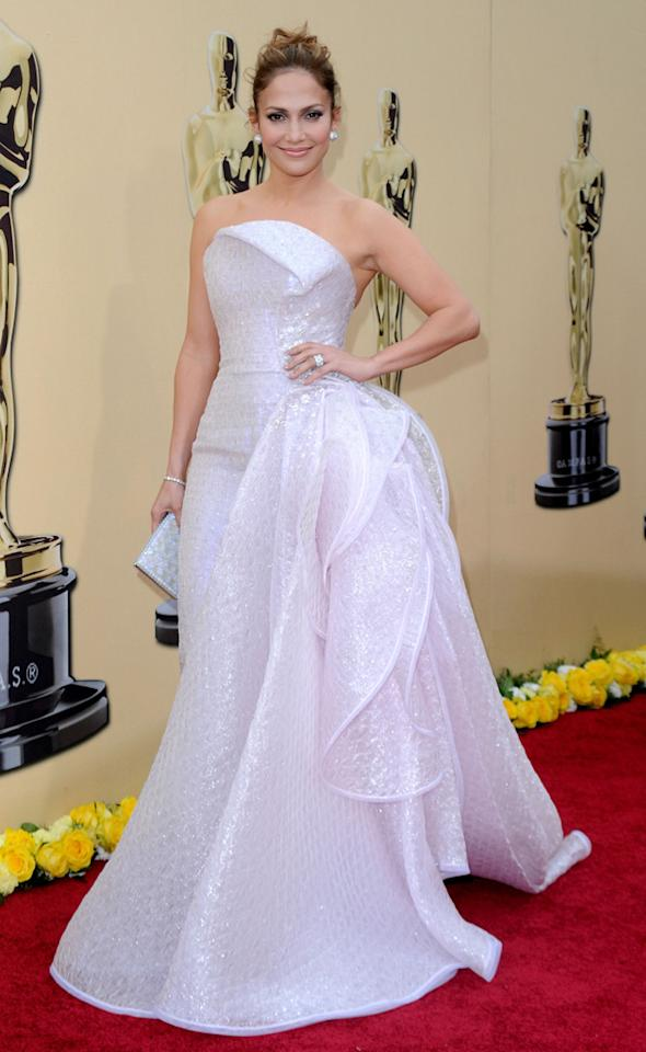 "Jennifer Lopez   Grade: B+    J.Lo's iridescent pink Armani Prive creation had the ""wow factor"" the diva said she was looking for in an Oscar gown. The cascading ruffles contributed to the dramatic effect."