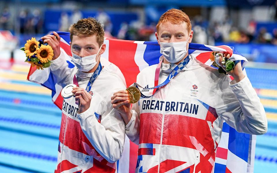 Team GB, Britain's Tom Dean claimed a stunning gold ahead of team-mate Duncan Scott in a thrilling 200m freestyle - Tokyo gold rush sees Team GB enjoy best start to an Olympics in modern history - PAUL GROVER FOR THE TELEGRAPH