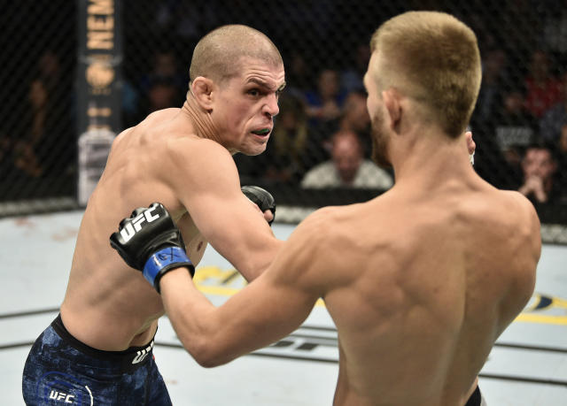 (L-R) Joe Lauzon punches Jonathan Pearce in their lightweight bout during the UFC Fight Night event at TD Garden on Oct. 18, 2019 in Boston. (Getty Images)