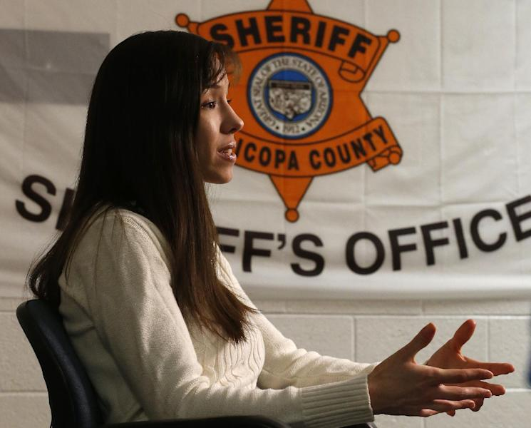 Convicted killer Jodi Arias makes a point as she answers a question during an interview at the Maricopa County Estrella Jail on Tuesday, May 21, 2013, in Phoenix. Arias was convicted recently of killing her former boyfriend Travis Alexander in his suburban Phoenix home back in 2008, made a plea in court for life in prison, instead of execution, saying she can contribute to society if allowed to live. (AP Photo/Ross D. Franklin)