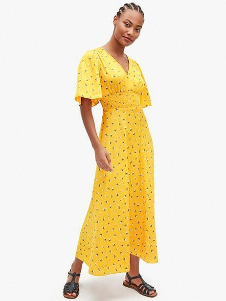 <p>For a dose of sunshine, slip on this <span>Kate Spade New York Dainty Bloom Satin Dress</span> ($378).</p>
