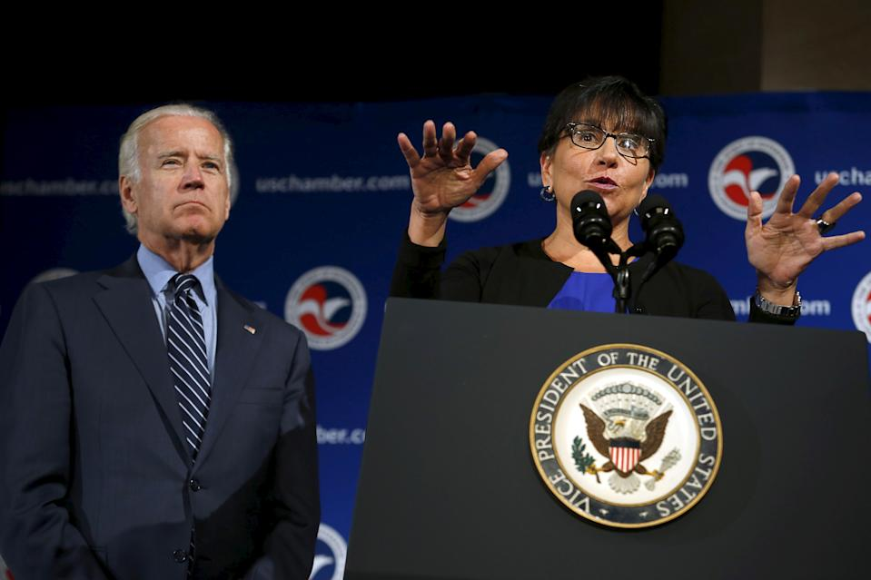 U.S. Commerce Secretary Penny Pritzker speaks next to U.S. Vice President Joe Biden (L) at the U.S.-Ukraine Business Forum in Washington July 13, 2015. REUTERS/Yuri Gripas