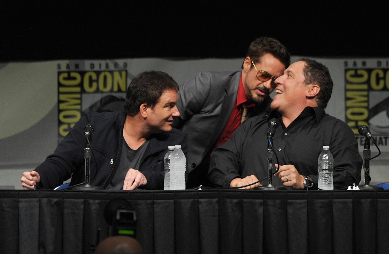 """SAN DIEGO, CA - JULY 14:  (L-R) Director Shane Black, actors Robert Downey Jr., and Jon Favreau speak at Marvel Studios """"Iron Man 3"""" panel during Comic-Con International 2012 at San Diego Convention Center on July 14, 2012 in San Diego, California.  (Photo by Kevin Winter/Getty Images)"""