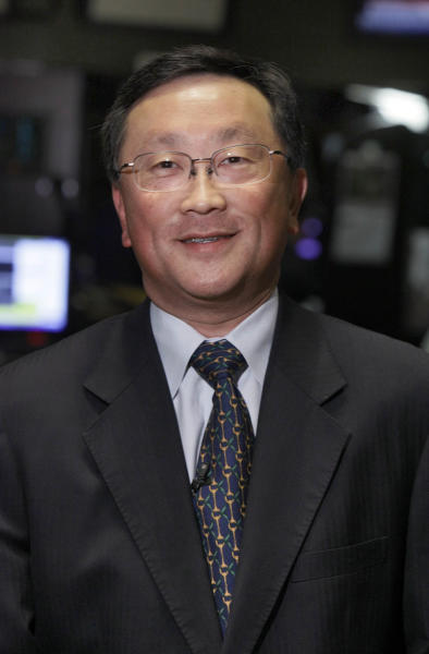 FILE - In this Thursday, May 20, 2010, file photo, John S. Chen, Chairman, CEO & President of Sybase, poses for a photo on the floor of the New York Stock Exchange. Chen was brought in as the interim chief executive of Blackberry in November 2013. On Monday, Nov. 25, 2013, the shakeup in Blackberry's executive offices goes on, with Chief Operating Officer Kristian Tear and Chief Marketing Officer Frank Boulben leaving the struggling smartphone maker. Brian Bidulka is also being replaced as chief financial officer. (AP Photo/Richard Drew, File)