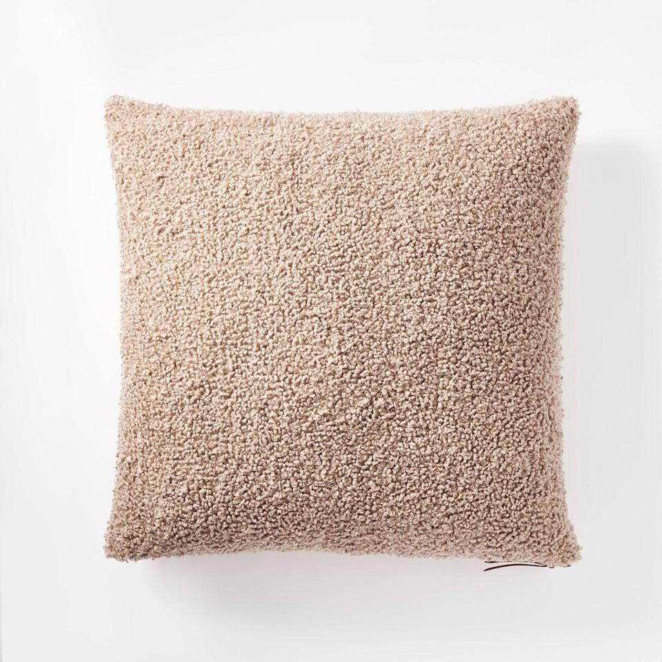 """<p><strong>Threshold x Studio McGee</strong></p><p>target.com</p><p><strong>$22.00</strong></p><p><a href=""""https://www.target.com/p/boucle-throw-pillow-with-exposed-zipper-threshold-designed-with-studio-mcgee/-/A-81298452"""" rel=""""nofollow noopener"""" target=""""_blank"""" data-ylk=""""slk:BUY NOW"""" class=""""link rapid-noclick-resp"""">BUY NOW</a></p><p>Warm up your seating with this throw pillow featuring a soft bouclé texture. </p>"""