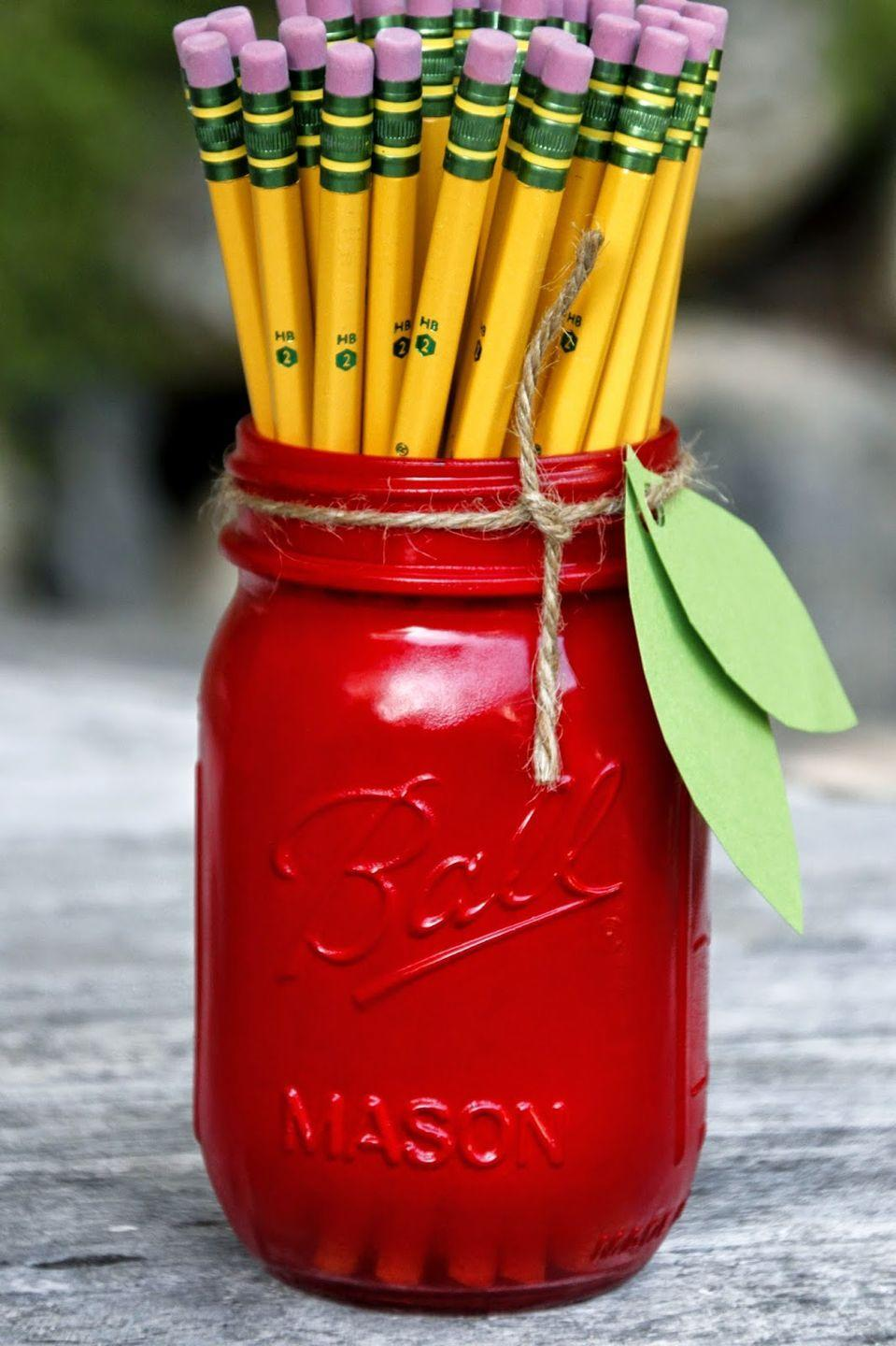 """<p>Use it as a pencil holder, or a catch-all for things like paper clips and thumb tacks. These also make great <a href=""""http://www.goodhousekeeping.com/holidays/gift-ideas/g1432/teacher-gifts/"""" rel=""""nofollow noopener"""" target=""""_blank"""" data-ylk=""""slk:teacher gifts"""" class=""""link rapid-noclick-resp"""">teacher gifts</a>. </p><p><em><a href=""""http://www.tillysnest.com/2014/08/down-home-blog-hopnumber-94-apple-mason.html"""" rel=""""nofollow noopener"""" target=""""_blank"""" data-ylk=""""slk:Get the tutorial at Tilly's Nest »"""" class=""""link rapid-noclick-resp"""">Get the tutorial at Tilly's Nest »</a></em></p>"""