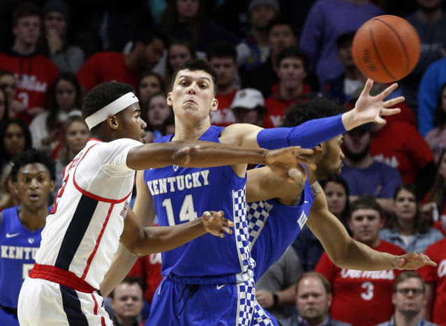 Mississippi guard Devontae Shuler (2) forces Kentucky guard Tyler Herro (14) to pass the ball during the first half of an NCAA college basketball game in Oxford, Miss., Tuesday, March 5, 2019. (AP Photo/Rogelio V. Solis)