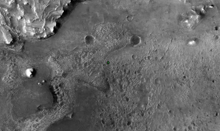 A green dot marks where NASA's Perseverance Mars rover landed in Jezero Crater on Mars
