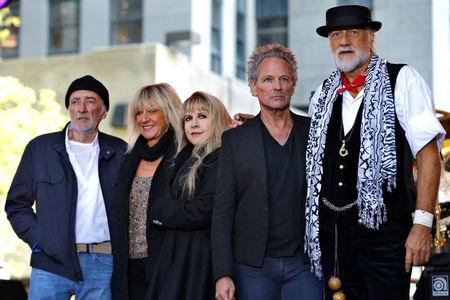 FILE PHOTO: Members of the rock band Fleetwood Mac stand together on stage after performing a concert on NBC's 'Today' show in New York City