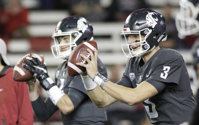 "Washington State quarterbacks <a class=""link rapid-noclick-resp"" href=""/ncaaf/players/252283/"" data-ylk=""slk:Tyler Hilinski"">Tyler Hilinski</a> (3) and <a class=""link rapid-noclick-resp"" href=""/ncaaf/players/230552/"" data-ylk=""slk:Luke Falk"">Luke Falk</a> take snaps during warmups before an NCAA college football game against Southern California in Pullman, Wash., Friday, Sept. 29, 2017. (AP Photo/Young Kwak)"