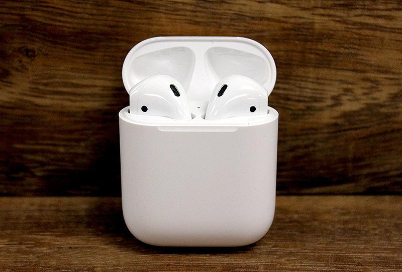 The AirPods come in a compact and convenient portable charging case.
