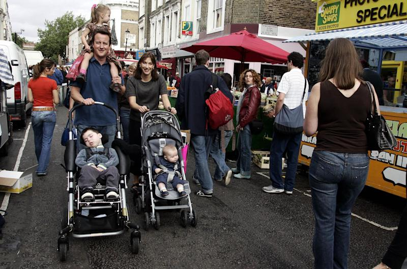Conservative Party leader David Cameron with his wife Samantha and their daughter Nancy (on shoulders) and sons Ivan (left) and Arthur shopping in Portobello Market in London, on the eve of the Conservative Party Conference in Bournemouth.