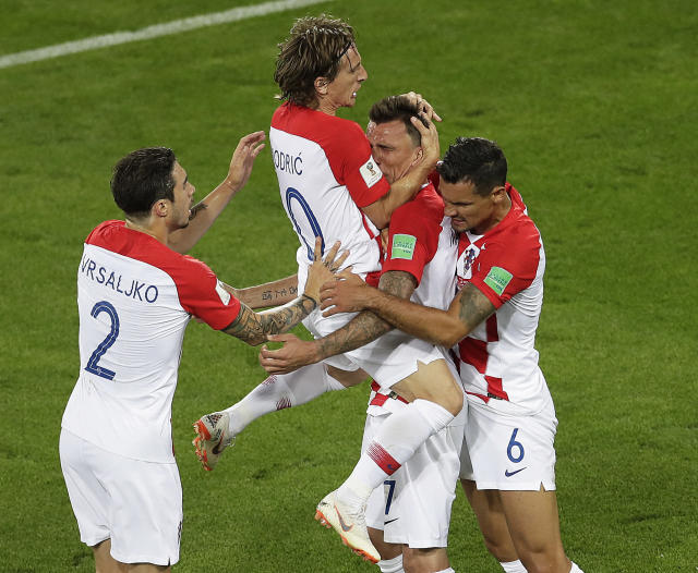 <p>Now more teammates join Mandzukic and Lovren in celebrating their goal. (AP) </p>