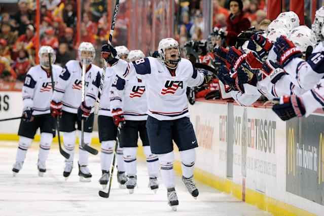 OTTAWA, CANADA - APRIL 9: Amanda Kessel #28 of Team USA celebrates her third period goal with teammates during the IIHF Womens World Championship Gold Medal Game against Team Canada at Scotiabank Place on April 9, 2013 in Ottawa, Ontario, Canada. # of Team USA defeated Team Canada 3-2. (Photo by Richard Wolowicz/Freestyle Photography/Getty Images)