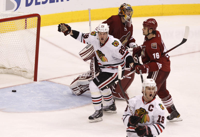 Chicago Blackhawks' Jonathan Toews (19) celebrates his game-winning goal as teammate Bryan Bickell (29) joins him in celebration as Phoenix Coyotes' Rostislav Klesla (16), of the Czech Republic, and Mike Smith skate away during overtime in Game 5 of an NHL hockey Stanley Cup first-round playoff series Saturday, April 21, 2012, in Glendale, Ariz. The Blackhawks defeated the Coyotes 2-1.(AP Photo/Ross D. Franklin)
