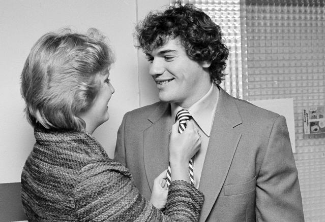"FILE - In this Dec. 3, 1980, file photo, Cleveland Indians outfielder Joe Charboneau gets a last-minute adjustment on his tie from his wife, Cindy, before a news conference to announce that Charboneau was selected the American League Rookie of the Year, in Cleveland. Charboneau sees a little bit of himself in the iconic baseball film ""The Natural."" The 1984 film starring Robert Redford finished tied for No. 8 in The Associated Press Top 25 favorite sports movies poll. (AP Photo/Mark Duncan, File)"