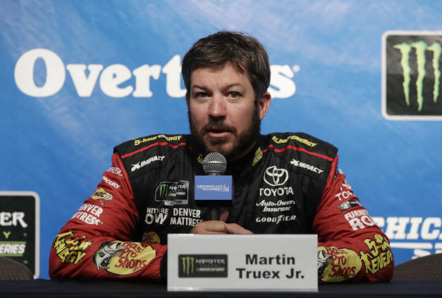"<a class=""link rapid-noclick-resp"" href=""/nascar/sprint/drivers/380/"" data-ylk=""slk:Martin Truex Jr."">Martin Truex Jr.</a>, speaks at a news conference at Chicagoland Speedway in Joliet, Ill., Saturday, June 30, 2018. (AP Photo/Nam Y. Huh)"